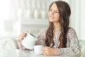 Girl pouring milk into cup Royalty Free Stock Photo