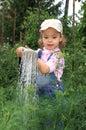 Girl pours a vegetable garden. Royalty Free Stock Photo