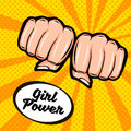 Girl power. Feminism symbol. Female fist, doodle colorful retro poster in the style of pop art. Royalty Free Stock Photo