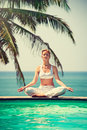 Girl practicing yoga. Royalty Free Stock Photo