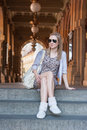 Girl in prague streets sitting on a stairs of the theater the of czech republic Royalty Free Stock Image
