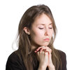 Girl praying isolated white portrait of an attractive beautiful pretty cute young caucasian woman lady female person model dressed Stock Photography