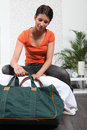 Girl preparing travel bag Royalty Free Stock Photo