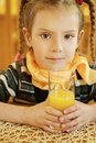 Girl-preschooler drinking orange Stock Image