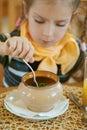 Girl-preschooler eats a tasty meal Royalty Free Stock Photo