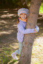 Girl-preschooler hands clasped tree Stock Photography