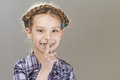 Girl preschooler put finger to lips happy Stock Images