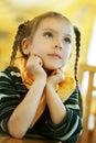 Girl-preschooler sitting at table Royalty Free Stock Photo