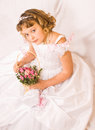 Girl pretends being bride Stock Photography