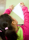Girl in primary school doing a test Royalty Free Stock Photo