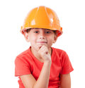 Girl in a protective helmet sits Royalty Free Stock Photo