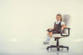 Girl proudly sits on a chair isolated Stock Images