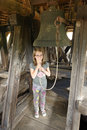 Girl pulling bell cord young in fortified church tower in transylvania romania Stock Images