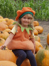 Girl pumpkin costume Stock Photos
