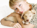 Girl and puppy tenderly embraces defenseless Royalty Free Stock Image