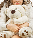 Girl with puppy toy Stock Photo