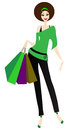 The girl with purchases comes back after sale Royalty Free Stock Images