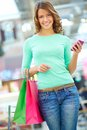 Girl with purchases vertical shot of a happy carrying her after shopping Royalty Free Stock Photos