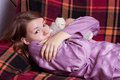 The girl in purple pajamas Royalty Free Stock Photography