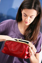 Girl and purse. Royalty Free Stock Photo