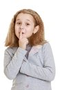 The girl put her finger to lips making quiet sign isolated on white background Stock Photos