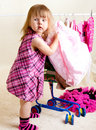 Girl putting clothing into trolley Royalty Free Stock Photo