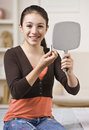 Girl Putting Makeup on in Mirror Royalty Free Stock Photo