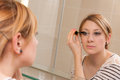 Girl Putting Makeup Royalty Free Stock Photo