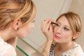 Girl Putting Makeup Royalty Free Stock Photo