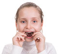 Girl putting on medical braces for orthodontic treatment over white Stock Images