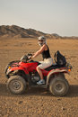 Girl on quad bike Stock Photography