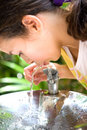 Girl quenching thirst Royalty Free Stock Photo