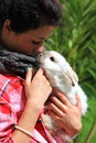 Girl and rabbit young holding her pet breed is angora Royalty Free Stock Photos