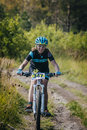Girl racer on bike rides on the trail Royalty Free Stock Photo