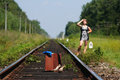 Girl on the railroad track with suitcase young Stock Photography