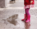 Girl at rainy day in springtime adorable years old Stock Images