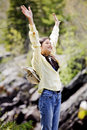 Girl raising hands in praise Stock Image