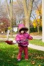 Girl Raking Leaves