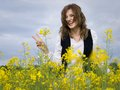 Girl in rapeseed field Stock Photos