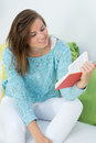 Girl read a book at her couch Royalty Free Stock Photo
