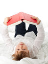 Girl reading book on bed education or knowledge concept Royalty Free Stock Photography