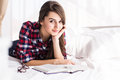 Girl reading a book in bed, Royalty Free Stock Photo