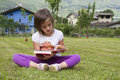 Girl reading a book in the garden Royalty Free Stock Photo