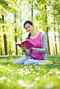 Girl reading a book outdoor Royalty Free Stock Image