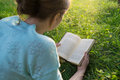 Girl reading a book in the park young beautiful Stock Photo