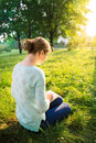 Girl reading a book in the park young beautiful Stock Image