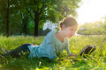 Girl reading a book in the park young beautiful Royalty Free Stock Photo