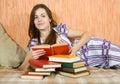 Girl reading book on sofa Royalty Free Stock Photo