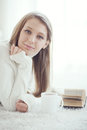 Girl reading book soft portrait of teenage at home Stock Images