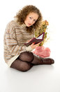 Girl reading a book in a sweater Stock Photography